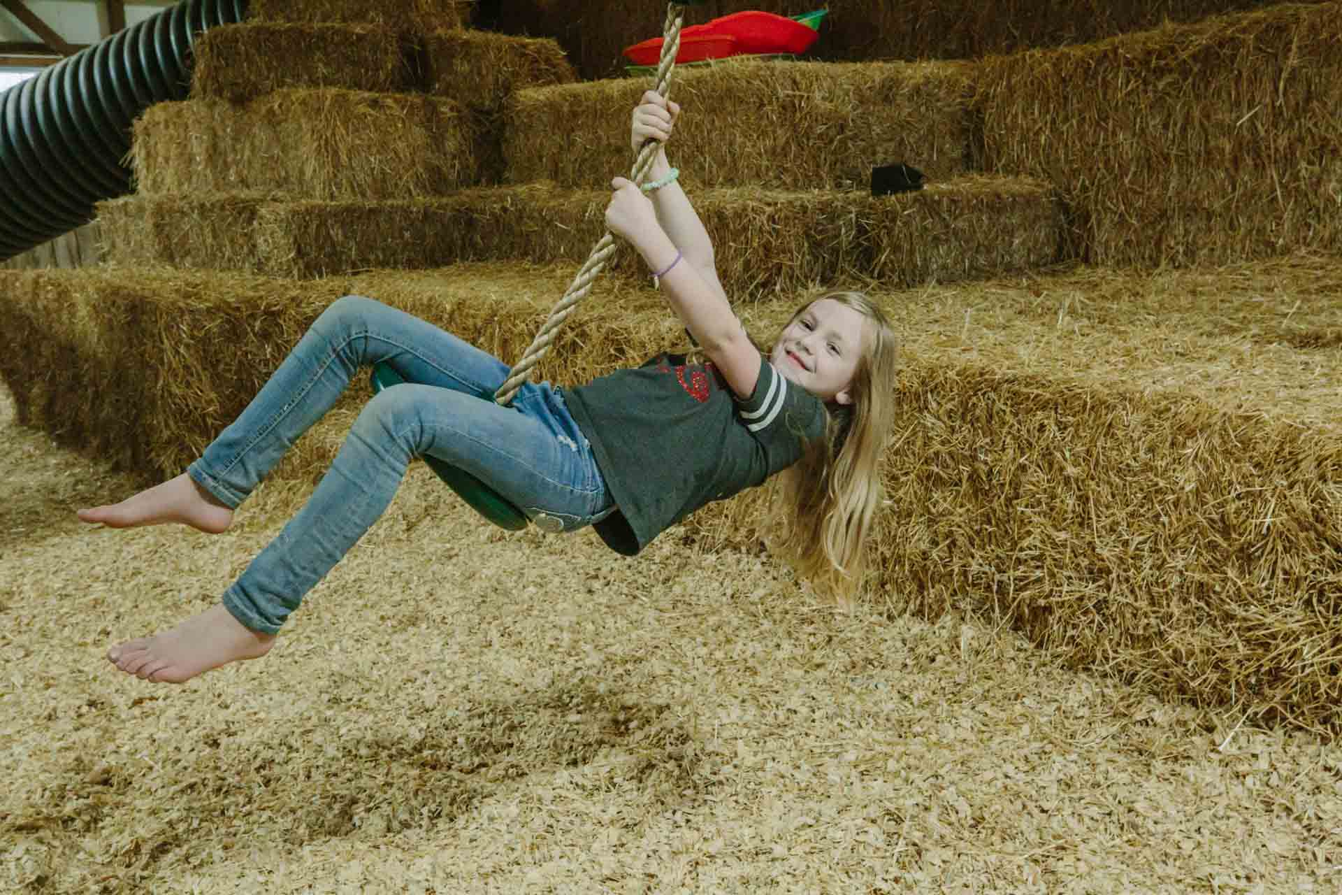 Fun in our climate-controlled indoor fun barn at Country Roads Family Fun Farm